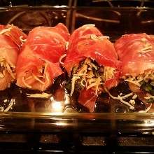 Spinach Stuffed Chicken Rolled in Prosciutto